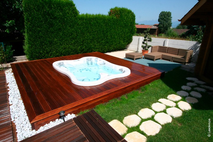 Lotus Bay hot tub on a deep wood deck.