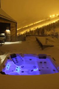 Hot tub in the snow overlooking the ski slopes