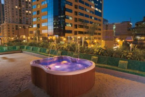 Large hot tub overlooking the city.